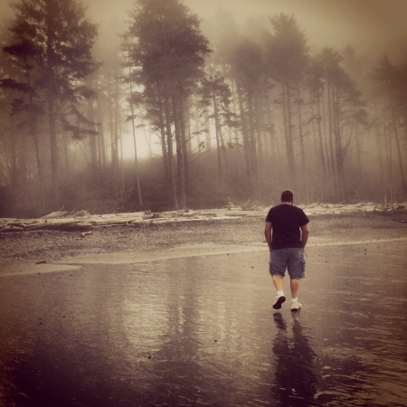 Walking along ruby beach in Washington  Stock Photo