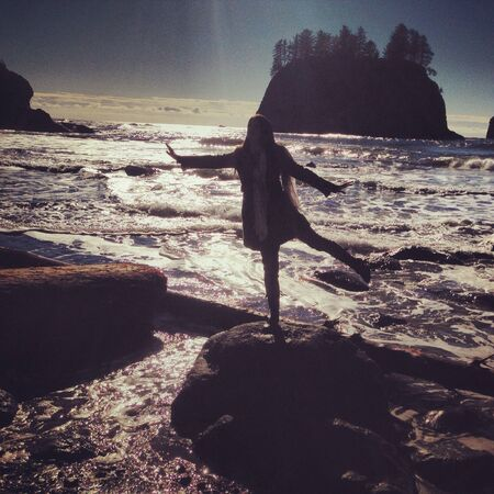 Girl dancing at la push beach