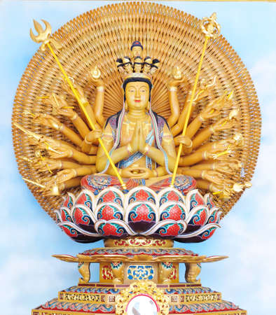quan yin: Quan Yin - Buddhist Goddess of mercy - statue isolated on gold