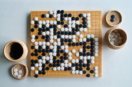 go to: Ended game Go board view from above Stock Photo