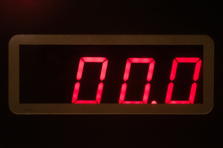 led display: Red seven-segment LED display on electronic weight scale panel showing zero.