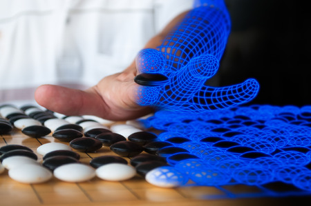 territory: Human playing Go blended to blue computer  wireframe representing artificial intelligence concept. Stock Photo
