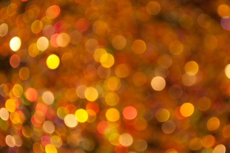 scattered bokeh of red orange and gold sparkling particles. can be used for background of many occasions such as christmas, new year, valentine, other celebration or festivals.