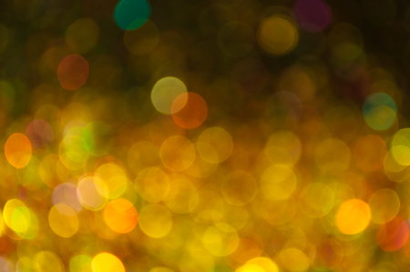 scattered bokeh of yellow and gold sparkling particles with few other colors. can be used for background of many occasions such as christmas, new year, valentine, other celebration or festivals.