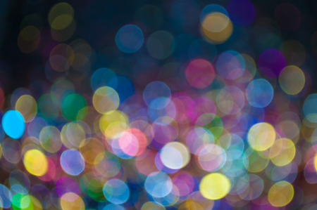 scattered bokeh of multicolor sparkling particles. useful as background for many occasions such as christmas, new year, valentine, other celebration or festivals.