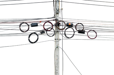 Several telecommunication line left as roles hanged on other wires on electric pole. Mostly fiber optic left uncut for future maintenance purpose. Isolated on white background.