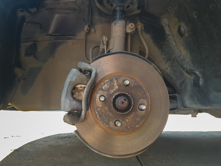 rusty and dirty car disc brake revealed after tire removed. Stock Photo