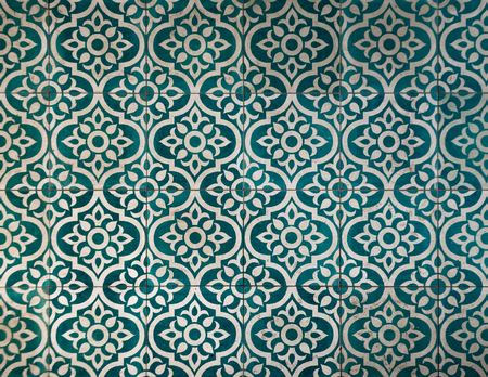 Ancient dark greenish blue and white tile pattern warn of buy time.