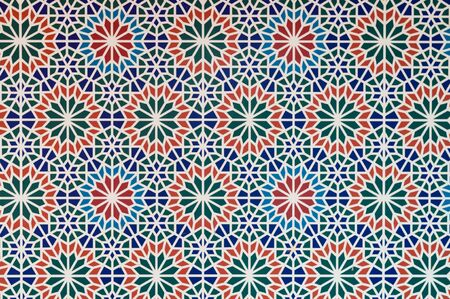 arabic style pattern multi color pieces of mosaics form white line pattern between them. Stock Photo