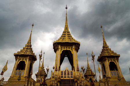 Thail Royal Crematorium for royal funeral of His Majesty King Bhumibol Adulyadej. With dark cloudy sky in background. Nation in grieve for lost of their great king of the modern era. Selected focus. Stock Photo