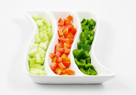 sliced  �  �  �  �: Sliced Tomatoes, Cucumber and Capsicum Salad served in a platter Stock Photo