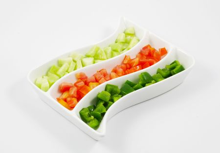 Sliced Tomatoes, Cucumber and Capsicum Salad served in a platter photo