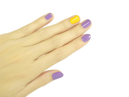 nails: Purple and yellow manicured nails