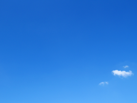 Clear blue sky with tiny clouds