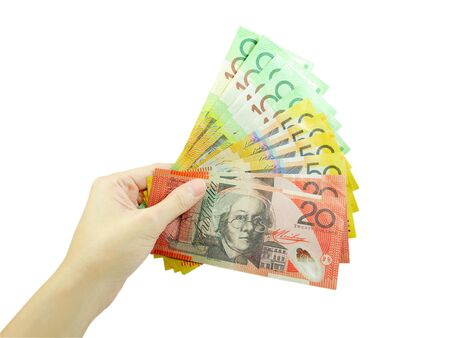 australian money: A womans hand holding Australian money