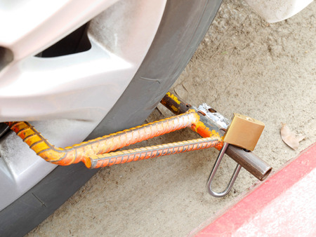 clamped: A wheel clamp attached to a vehicle in Thailand