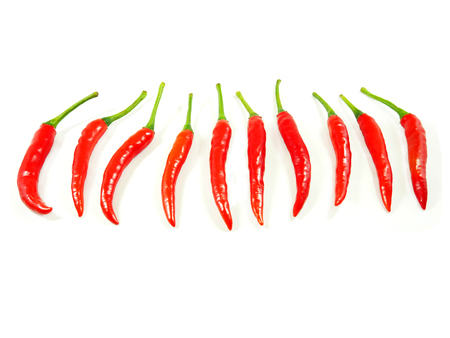 spur: Red chili spur pepper isolated on white background