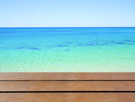 busselton: Clear blue sea and wooden table