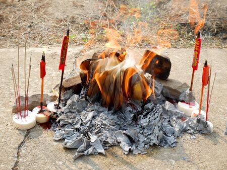 Ancestor offering burning at cemetery on Tomb Sweeping Day