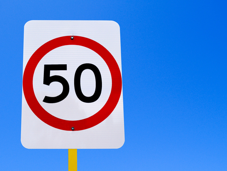 sky is the limit: 50 speed limit sign on clear blue sky Stock Photo