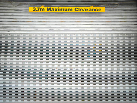 maximum: 3.7m Maximum Clearance sign at doorway Stock Photo