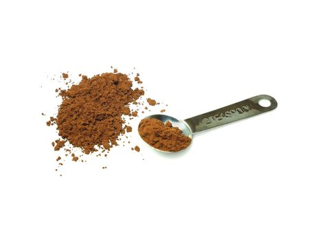 measuring spoon: Cocoa powder and measuring spoon isolated on white background