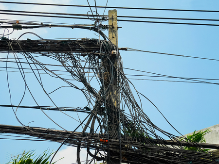 utility pole: Utility pole supporting messy wires for various public utilities