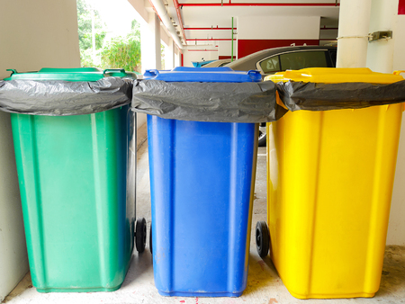 Rubbish bins in car park Stock Photo