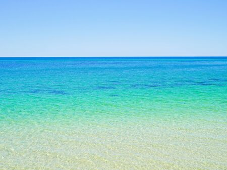 busselton: Crystal clear blue ocean water background Stock Photo