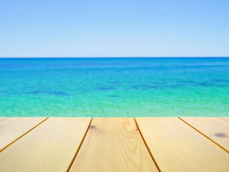 busselton: Wooden table on blurred clear blue ocean background