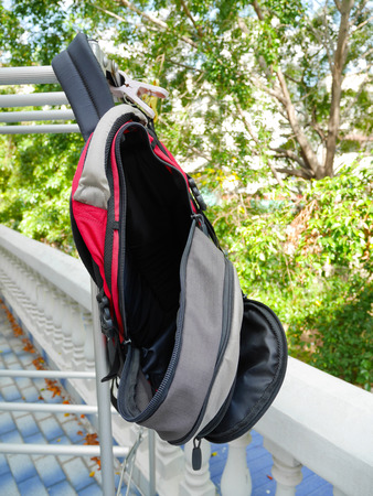 used clothes: Rucksack hanging on clothes rack after used