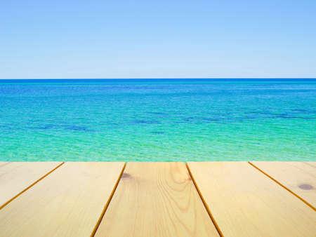 busselton: Wooden table on beautiful clear blue ocean background
