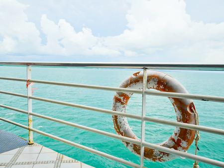 Life buoy hanging on railing