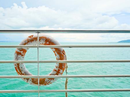 buoy: Life buoy hanging on railing