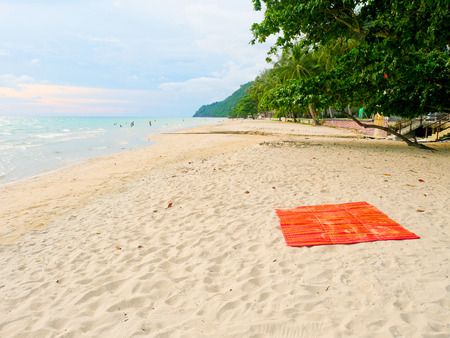 beach mat: Red mat on the beach in Koh Chang, Thailand Stock Photo