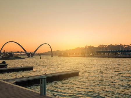 Boat pier for tourists at Elizabeth Quay at sunset. Low key. Stock Photo