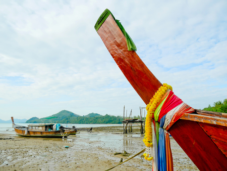 Bow of boat with garland and colorful cloths. Thai traditional style.
