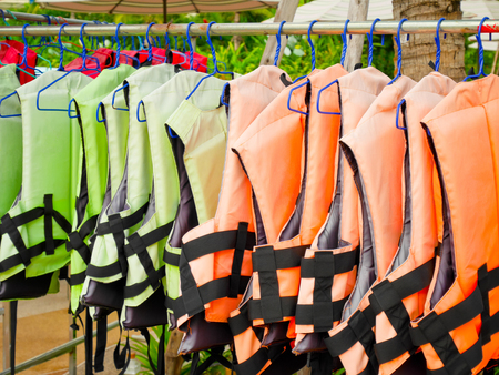 Life jackets hanging on a rack in water park