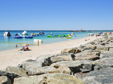 busselton: People enjoying their activities on the beach in summer