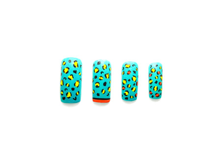 artificial nails: Leopard nail art on artificial nails Stock Photo