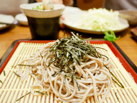 Zaru soba or cold soba noodles with seaweed on top. Japanese food.