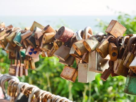 Love padlocks locked to a fence