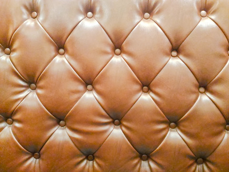 Vintage brown couch with buttoned pattern