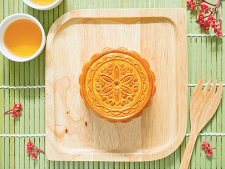 Mooncake on a wooden plate for Mid-Autumn Festival or Harvest Festival Stock fotó