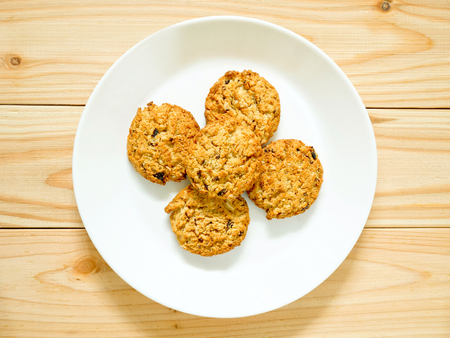 round: Oatmeal cookies with raisin on a white plate Stock Photo