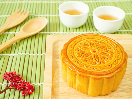Mooncake on a wooden plate for Mid-Autumn Festival or Mooncake Festival