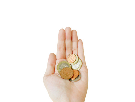 British coins in hand isolated on white background (with clipping path) 版權商用圖片