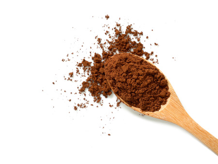 Pile of cocoa powder in wooden spoon isolated on white background. Top view. 스톡 콘텐츠