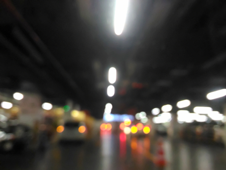 Blurred car park or parking lot and traffic congestion in shopping mall Stock Photo