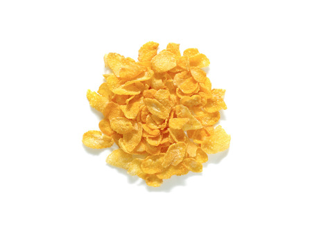 Pile of cornflakes breakfast cereal isolated on white background. Top view. Healthy breakfast concept.